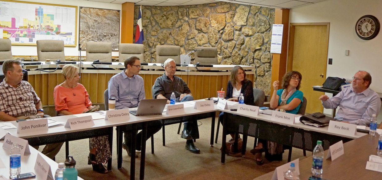 Members of the Craig community provide feedback to Brian Lewandowski, associate director of the business research division at University of Colorado at Boulder as part of a study on the economies of rural communities. The meeting took place in Craig City Council chambers Monday afternoon.