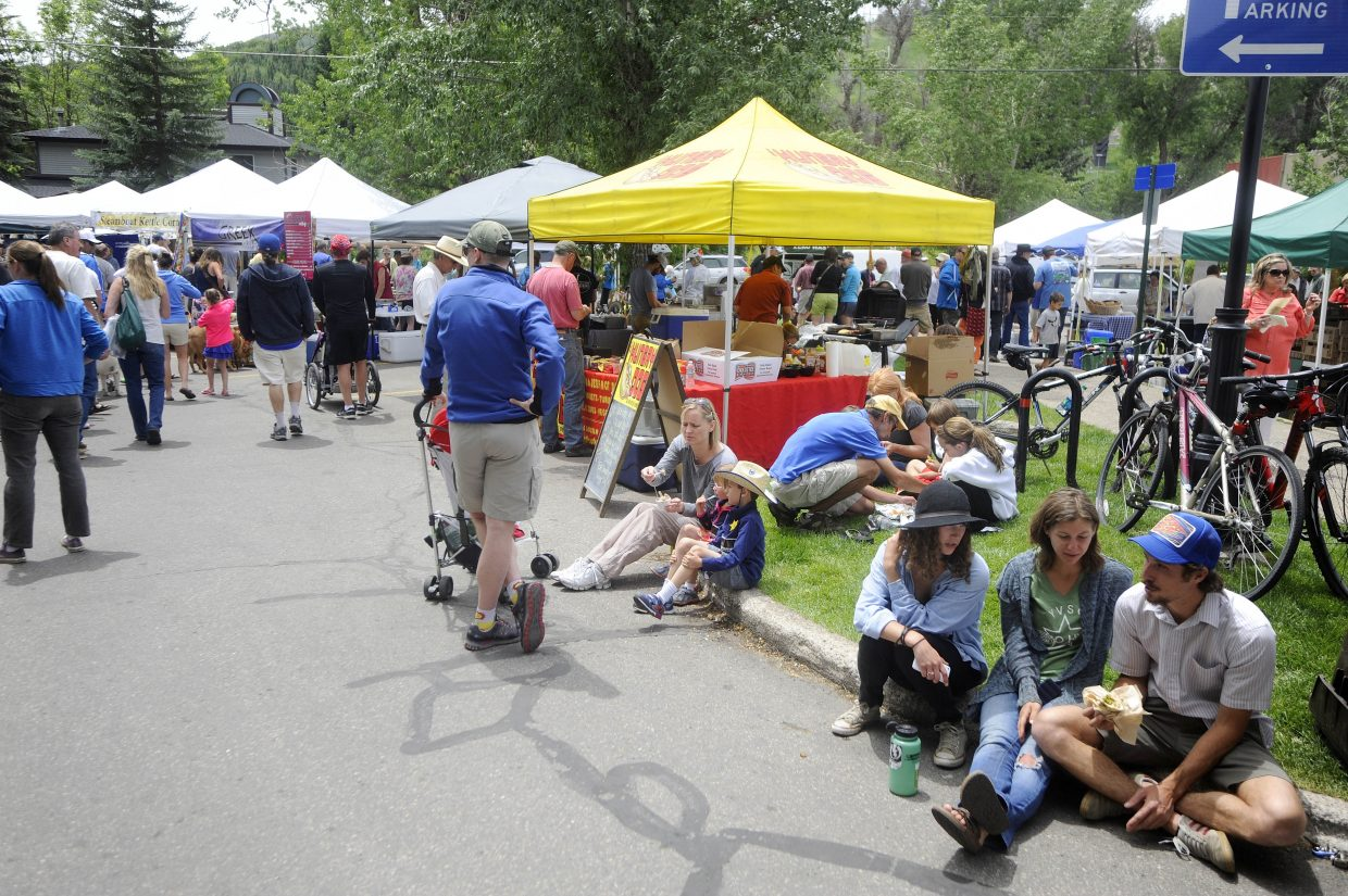 People pack the first Mainstreet Steamboat Springs' annual Farmers Market of the summer on Saturday. Mainstreet Manager Tracy Barnett said the new location at Seventh and Yampa Streets worked out well for vendors.