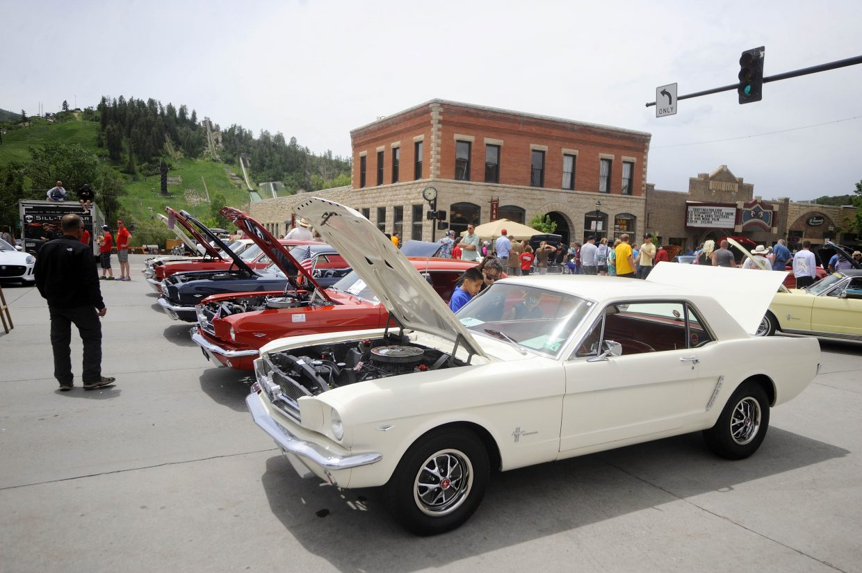 The original 1964.5 model Ford Mustangs are highlighted at Eighth Street and Lincoln Avenue. The Mustang community is celebrating the 50th anniversary of the car.