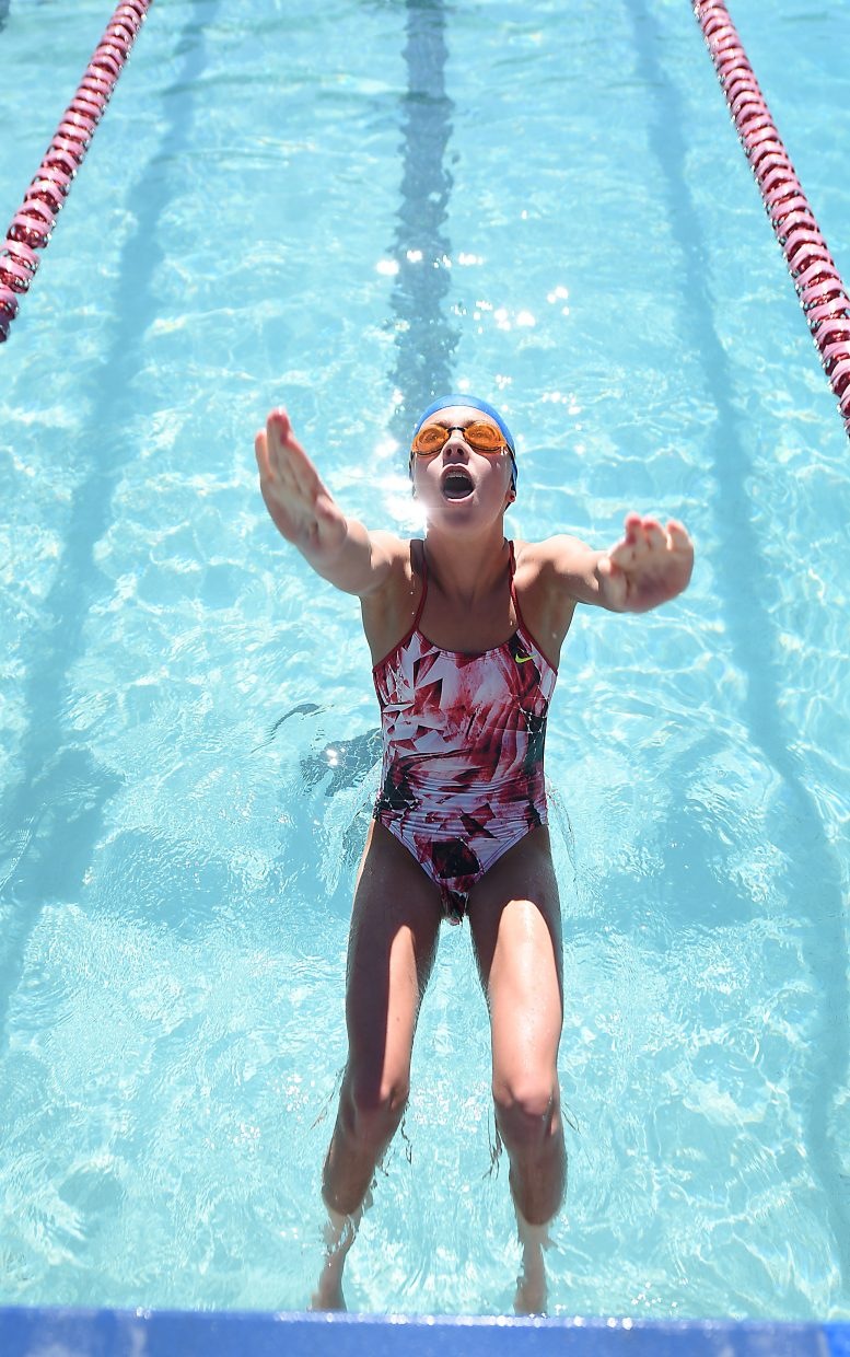 Jenna Smith dives into the pool while working on her backstroke Monday during a Steamboat Springs Swim Team practice at Old Town Hot Springs in downtown Steamboat. Smith, 11, has helped lead the way early this season for Steamboat's swimmers.