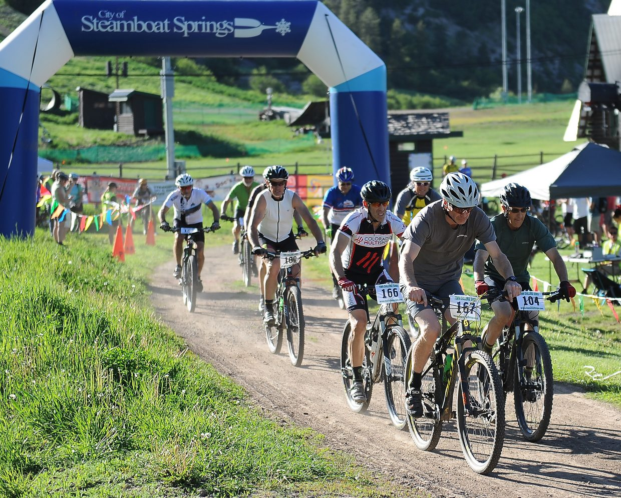 Riders tear away from the starting line at the base of Howelsen Hill during a Town Challenge Mountain Bike race.