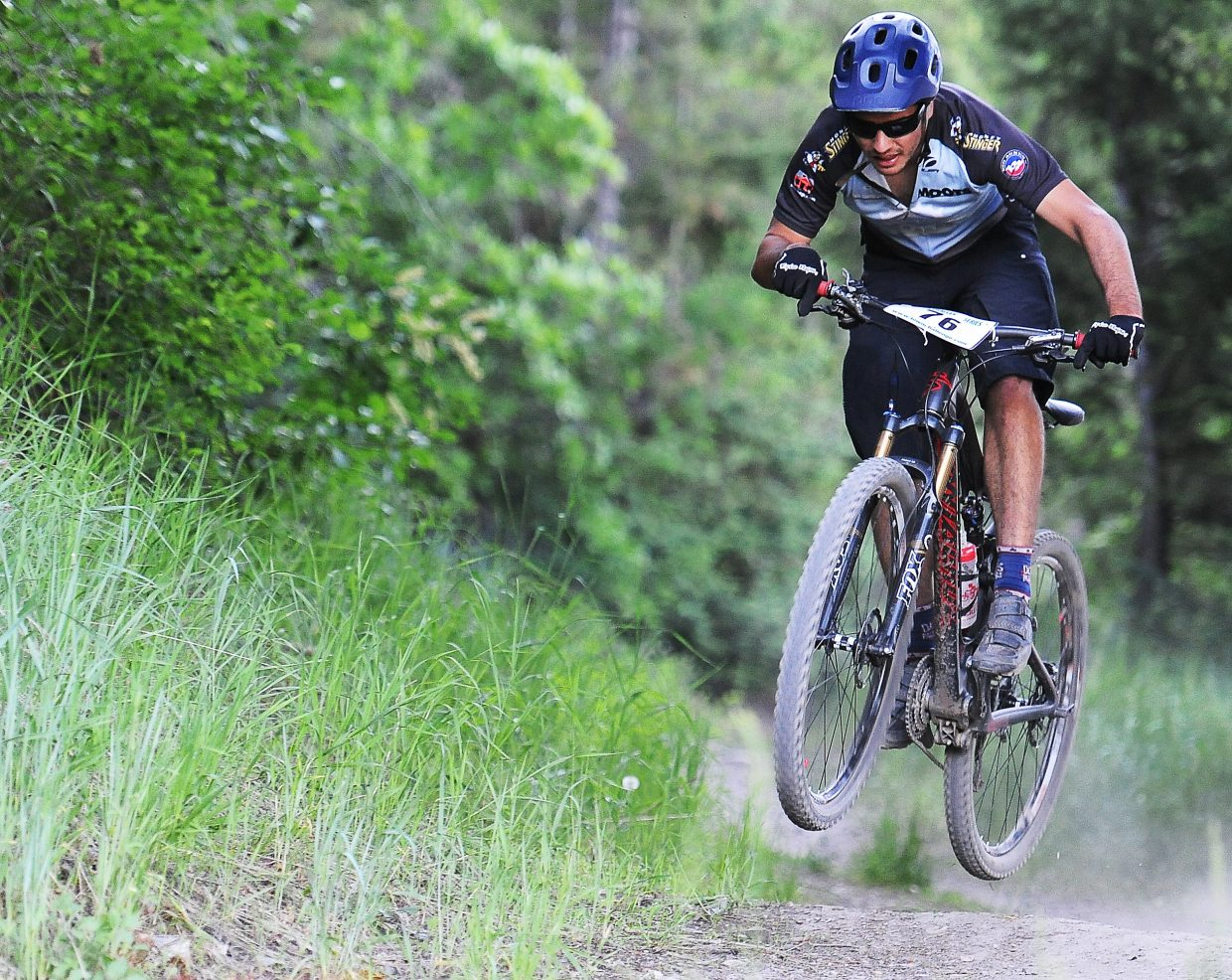 Jeff Minotto catches some air racing during a Town Challenge mountain bike race at Howelsen Hill earlier this month. The race series returns Wednesday for a race at Steamboat Ski Area.