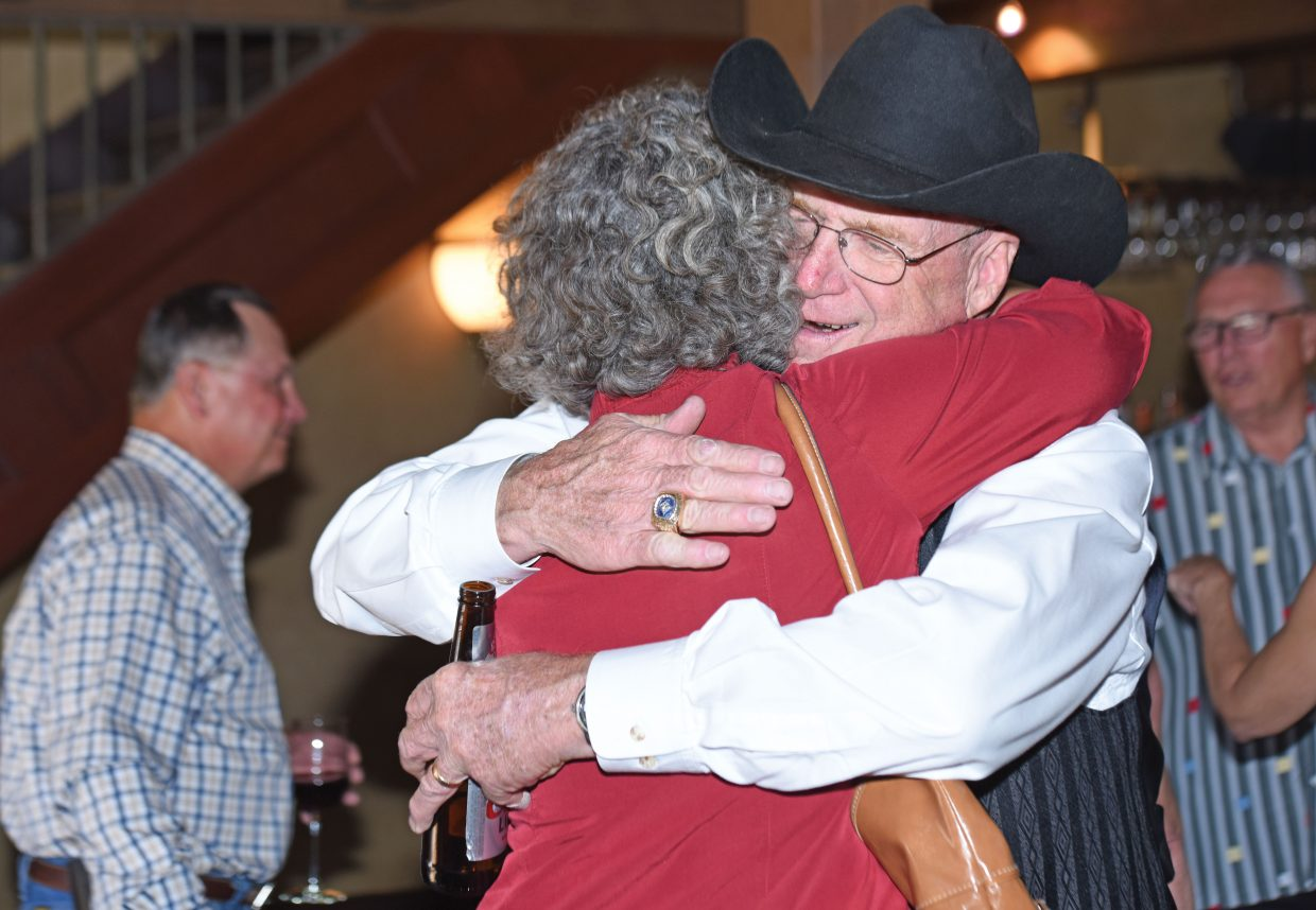 Dean Vogelaar greets Nancy Perricone with a hug at the door of the Ghost Ranch Saloon Wednesday afternoon during his retirement party from Mountain Valley Bank. The longtime Steamboat Springs resident is an active community member and previously served as executive director of the Steamboat Springs Chamber Resort Association, worked at Community First Bank and First National Bank before being named senior vice president and chief operating officer of Mountain Valley Bank when it opened in 2004. Before moving to Steamboat, Vogelaar served as vice president of public relations for the Kansas City Royals.