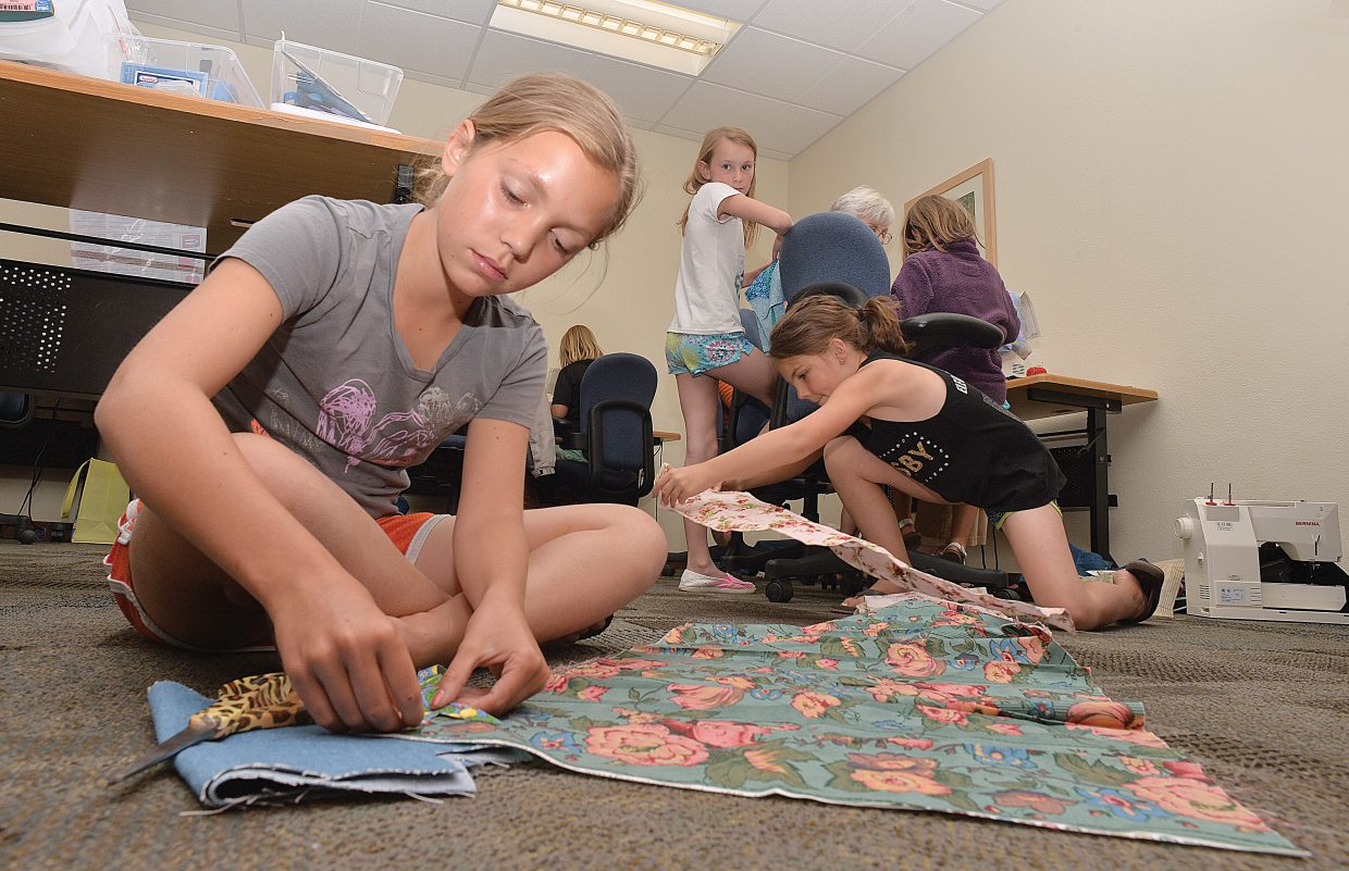 Ella Chapman works on her 4-H project at the Routt County Extension Office Monday. It was the first day of the 4-H sewing program where members will complete sewing projects, which will be judged later this summer prior to the start of the Routt County Fair.