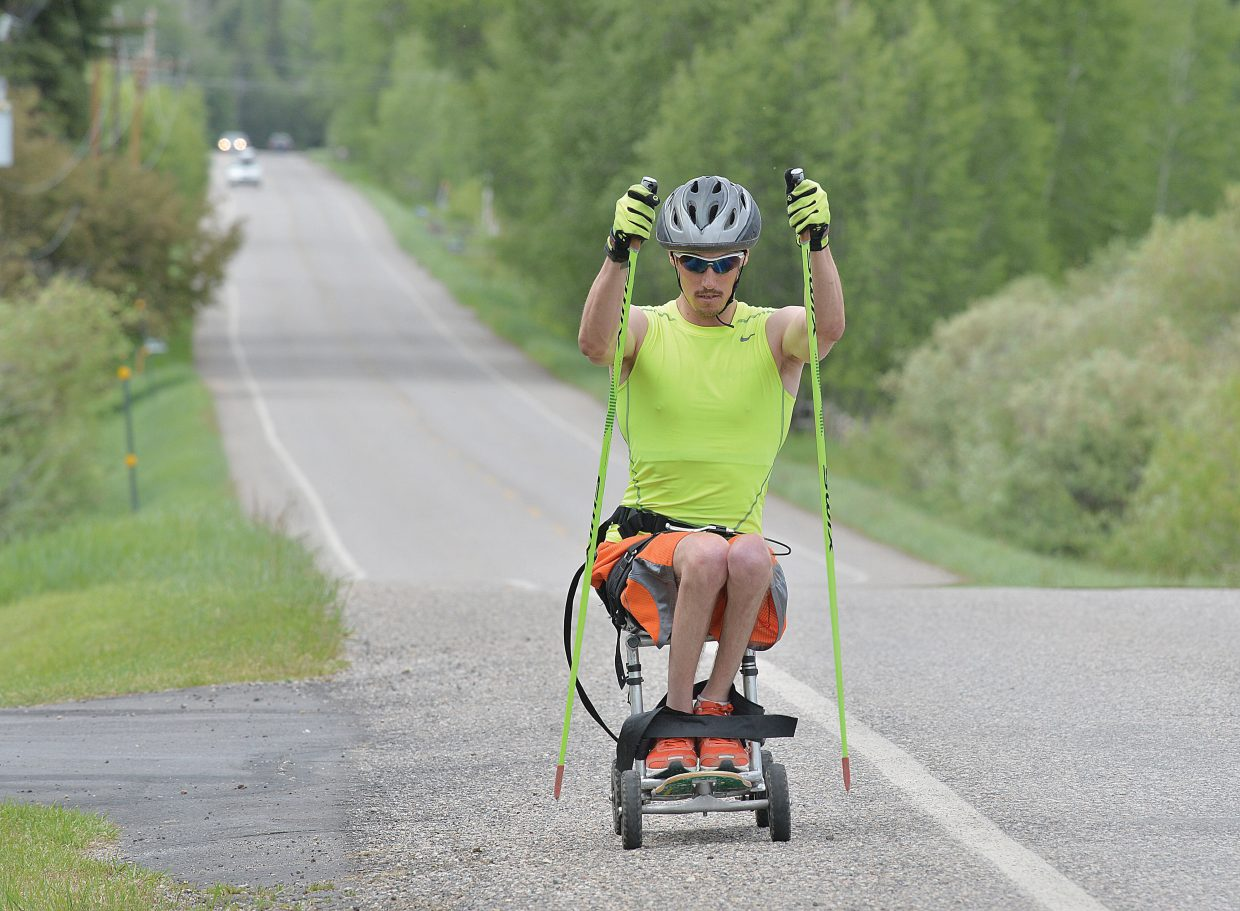 Bryan Price, who picked up ninth and 18th place finishes at the 2014 Paralympics in Sochi, Russia, trains along Routt County Road 36 Monday afternoon in Strawberry Park. Price, who was seriously injured by a roadside bomb while deployed in Iraq in 2006, said he is thinking about moving to Steamboat Springs and is working for a chance to compete at the next Paralympics Games in Pyeongchang, South Korea.