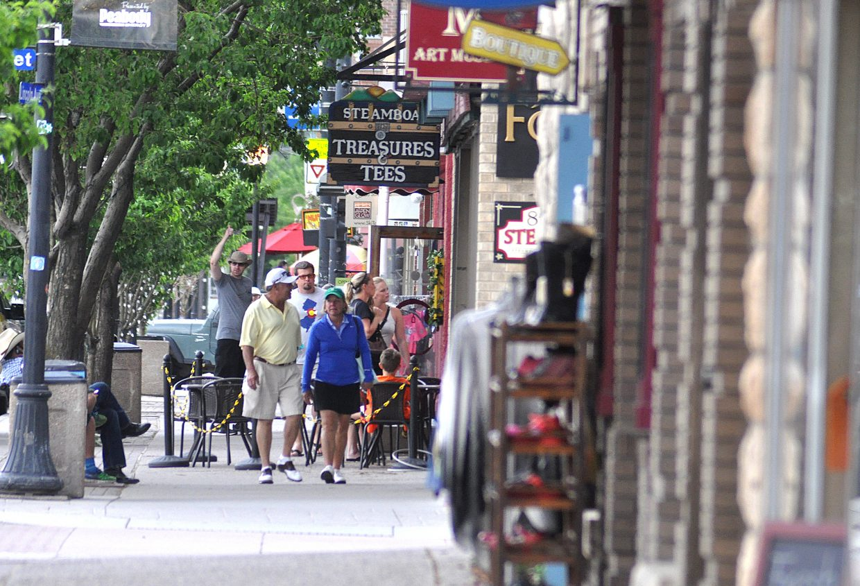 Shoppers stroll through downtown Steamboat Springs on a summer afternoon.