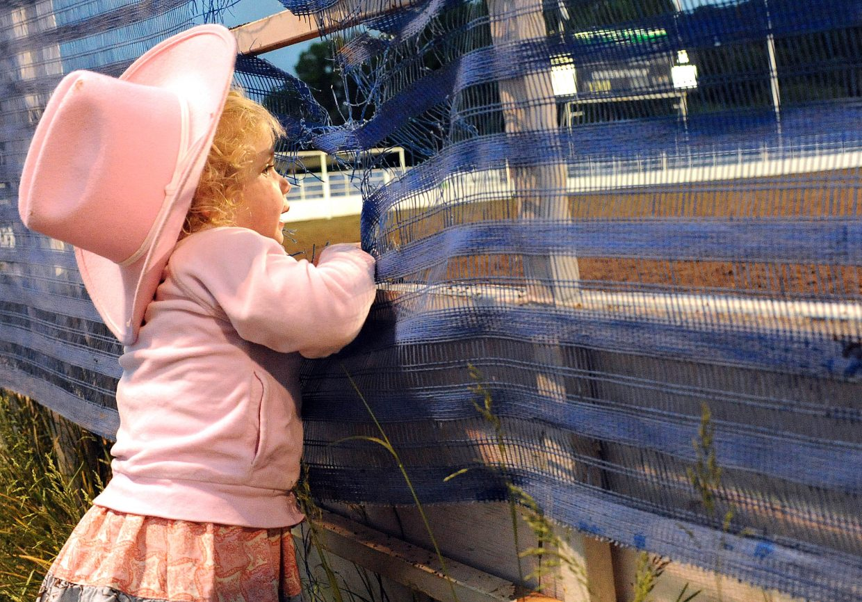 Hannah Records, 2, watches the action at Brent Romick Rodeo Arena in downtown Steamboat Springs in 2011. The rodeo grounds soon will start to get their biggest makeover in more than 20 years.