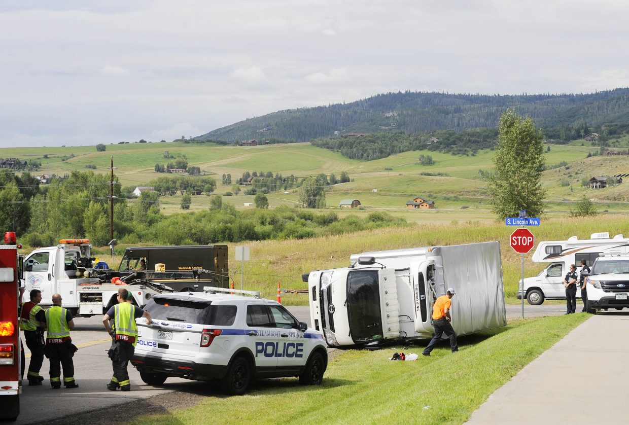No one was injured when this box truck rolled over Tuesday morning at South Lincoln Avenue and JD Hays Way near the Mountain Fire Station. The driver told police the truck's brakes went out after descending Rabbit Ears Pass, so he tried to turn onto JD Hays Way. The driver was delivering about 70 cases of wine to local restaurants.