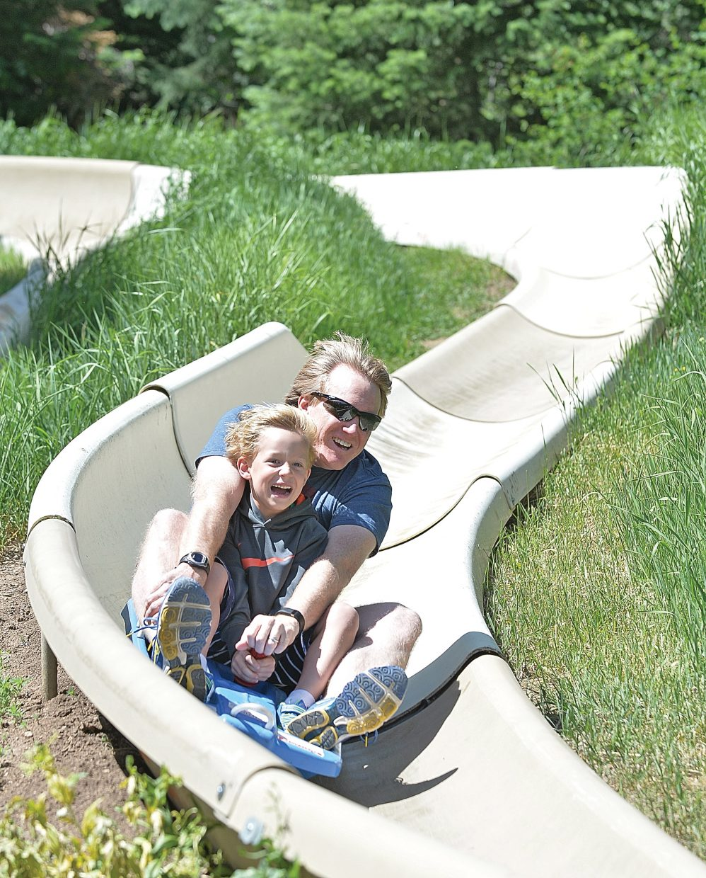 Houston residents Mark Murray, back, and Carson Murray speed down the Alpine Slide while visiting Steamboat Springs on vacation.