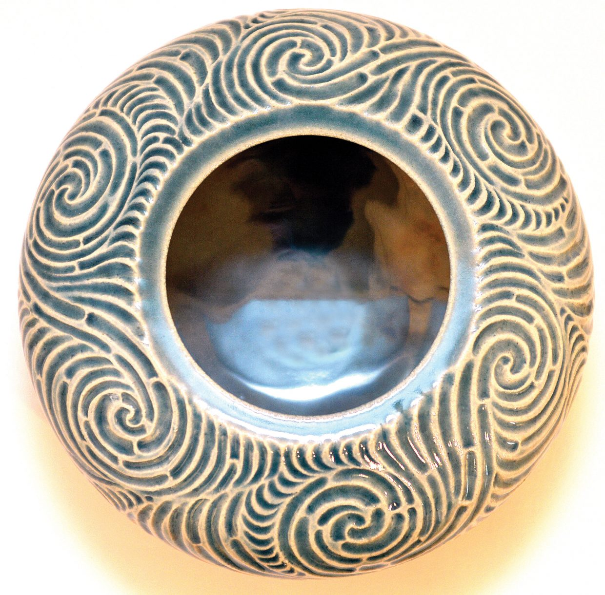 River Vessel by Julie Anderson is being featured in the Clay Artisans show, The Yampa Valley Curse, which is currently on display at the Steamboat Depot Art Center.