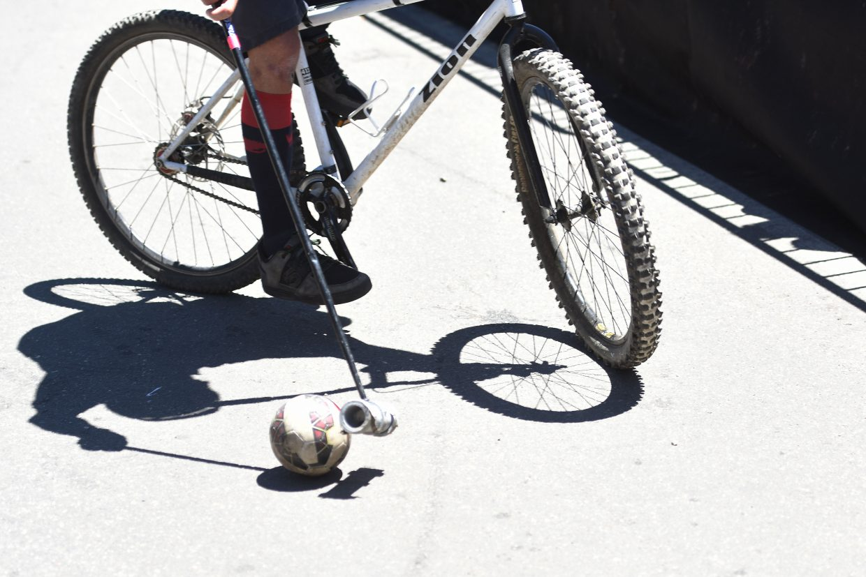 Balance can be a big factor in bike polo. When a rider loses balance and has to put a foot down, he or she has to ride behind the team's goal before playing again.