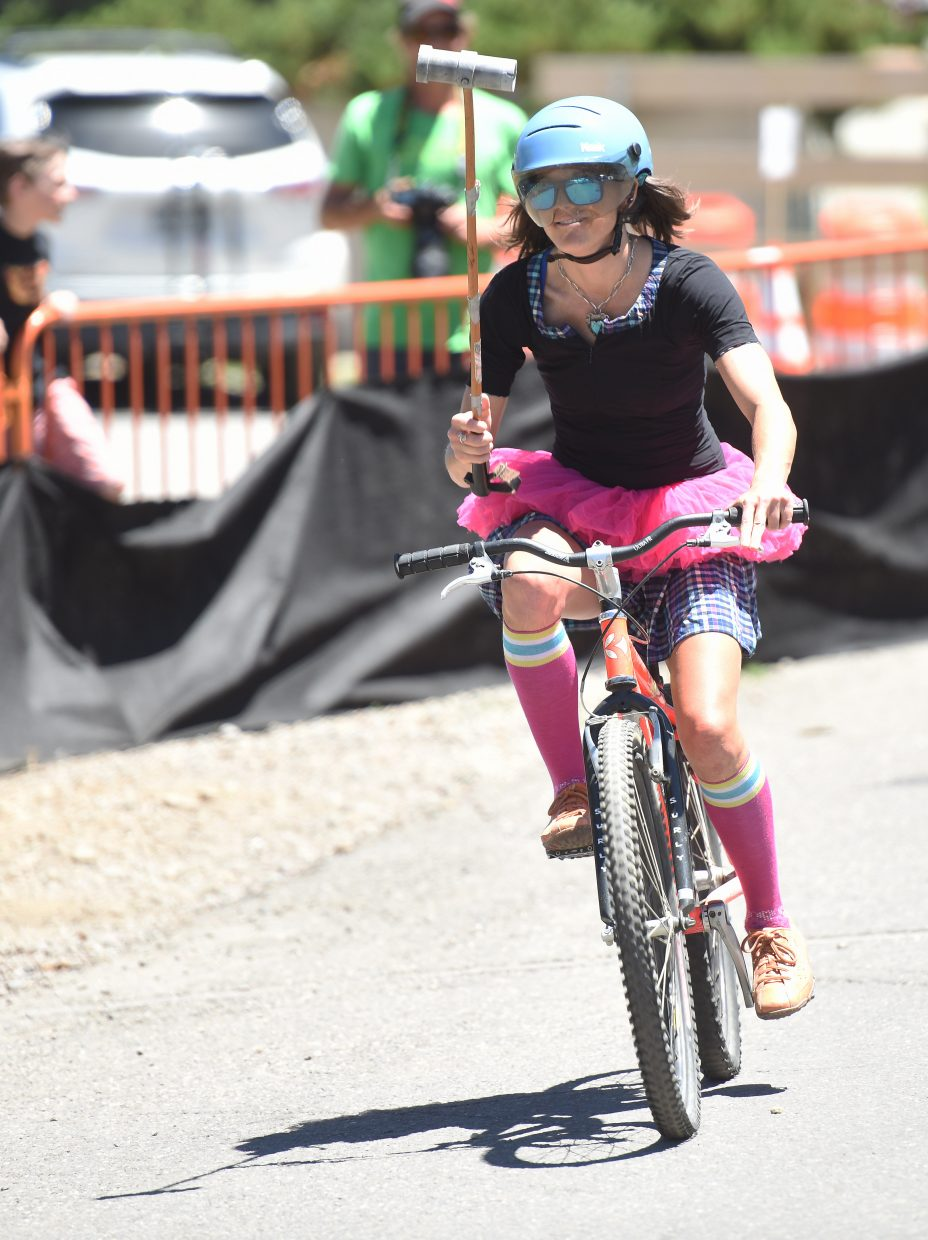 Mindy Mulliken celebrates after scoring a goal Saturday in a bike polo tournament in Steamboat Springs.