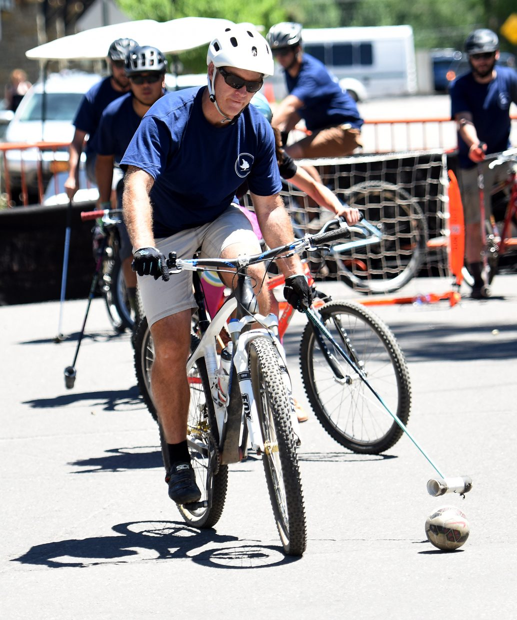 The team advances the ball up the court Saturday during a bike polo tournament on Yampa Street in Steamboat Springs.