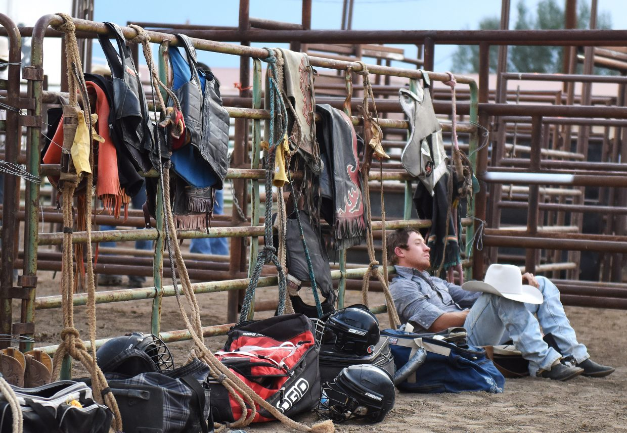 A cowboy takes a break while waiting for the start of the Jake Booco Invitational Bull Riding at the Routt County Fair in Hayden.