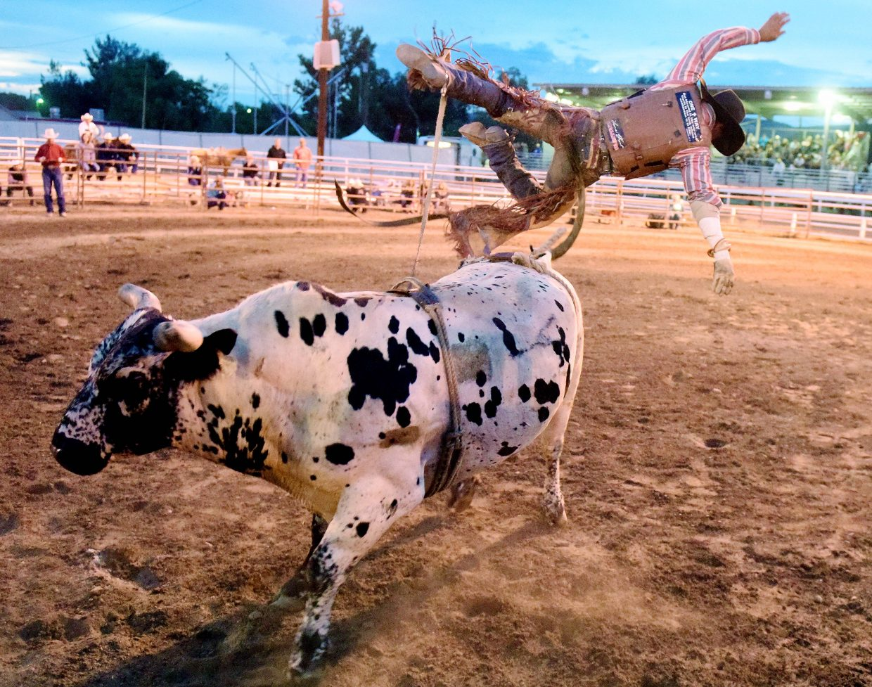 Dillon Kujala, from Burns, flies far off his bull, Funky Monkey, Thursday during the Jake Booco Invitational Bull Riding at the Routt County Fair in Hayden. Kujala landed hard, but only after he registered one of the night's few eight-second rides. He had a score of 84.
