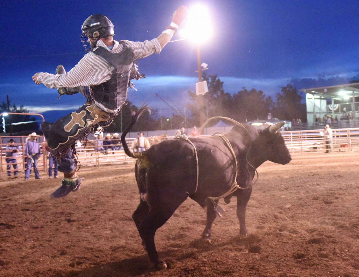 MaKenzie Fair, from Fort Collins, flies off the back of his bull Thursday at the Routt County Fair in Hayden.