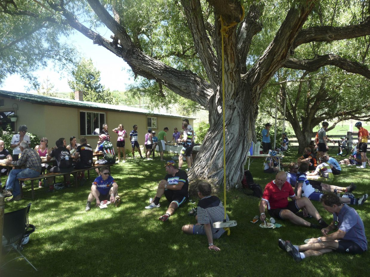 Cyclists eat lunch at the Rocking C Bar Ranch.