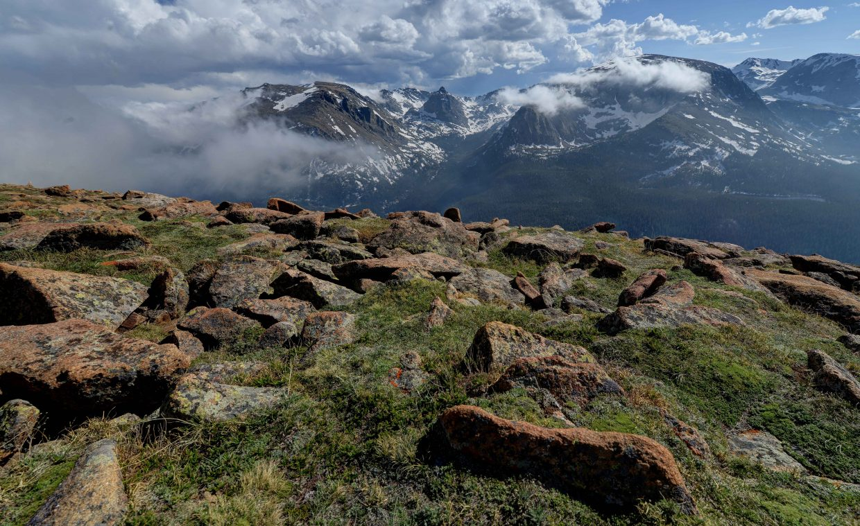 Clouds wrap around the mountains at the top of Rocky Mountain National Park earlier this month.