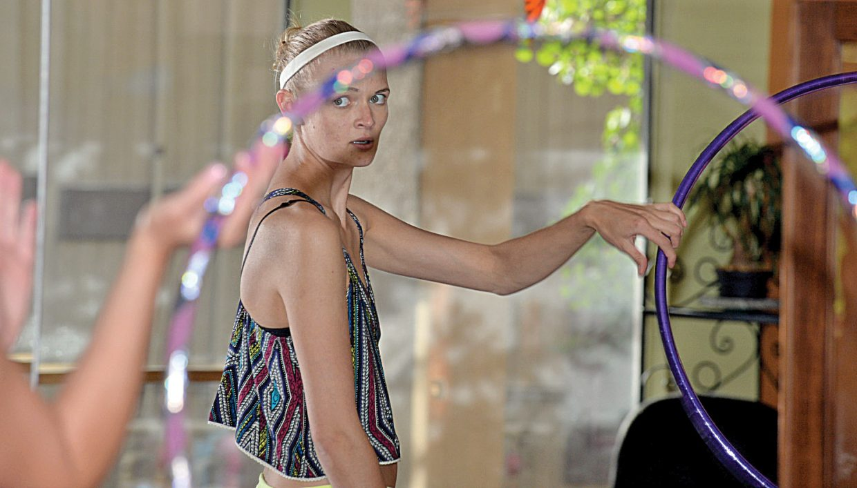 Sasha Kreissing looks to instructor Meg Rose for guidance while taking a hoop class at Sundance Studio in Steamboat Springs.