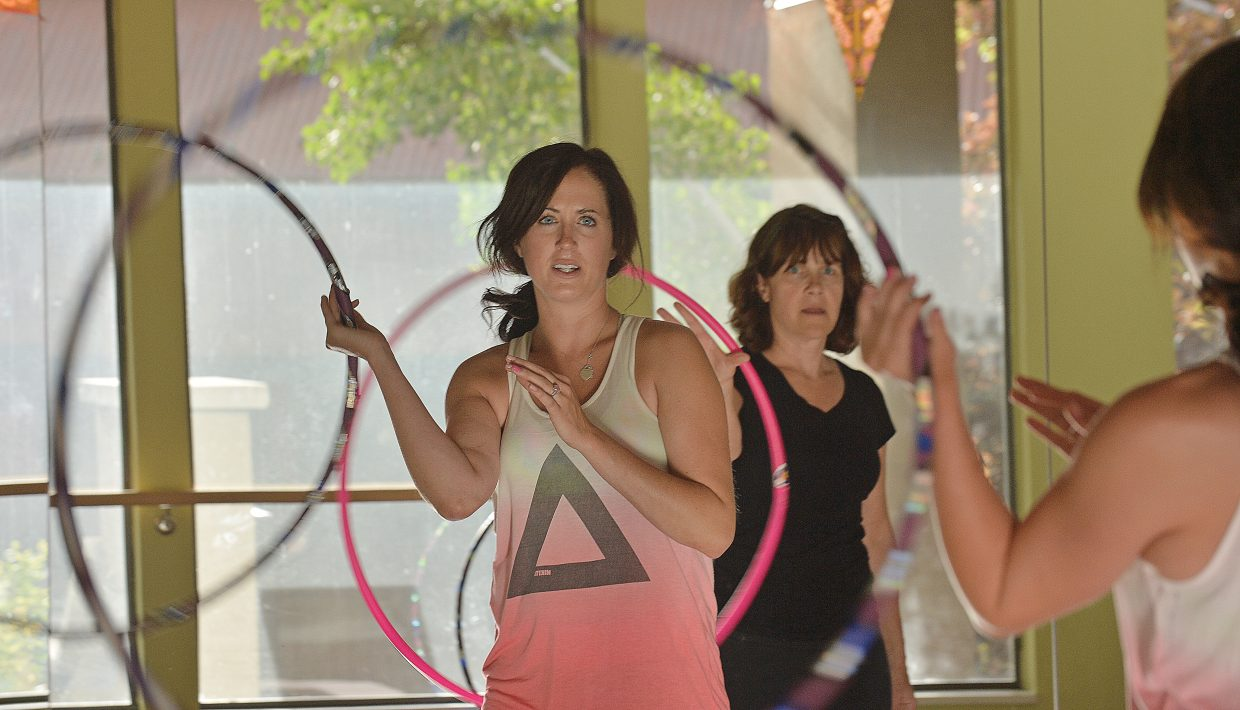 Instructor Meg Rose leads a hoops class at the Sundance Studio in Steamboat Springs.
