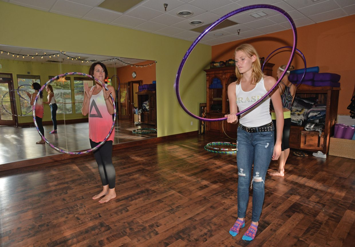 Taylor Kreissing looks to instructor Meg Rose for guidance while taking a hoop class at Sundance Studio in Steamboat Springs.
