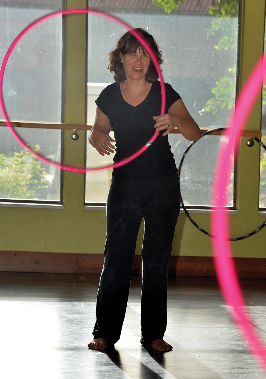 Audrey Warden smiles while taking a hoop class at Sundance Studio in Steamboat Springs