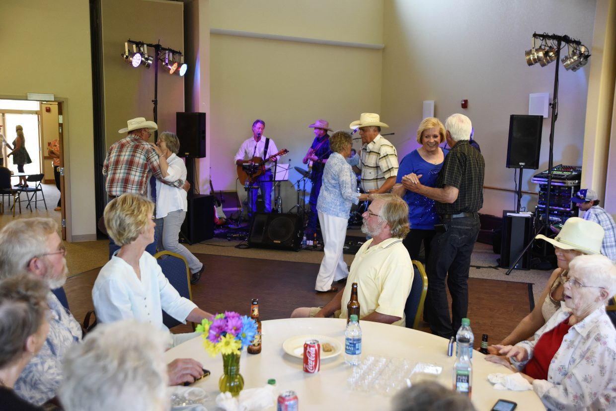 Community members dance to Loose Change during the Annual Barbecue and Barn Dance on Friday at the Haven Community Center in Hayden. The event was a fundraiser, with proceeds going toward repairs at The Haven.