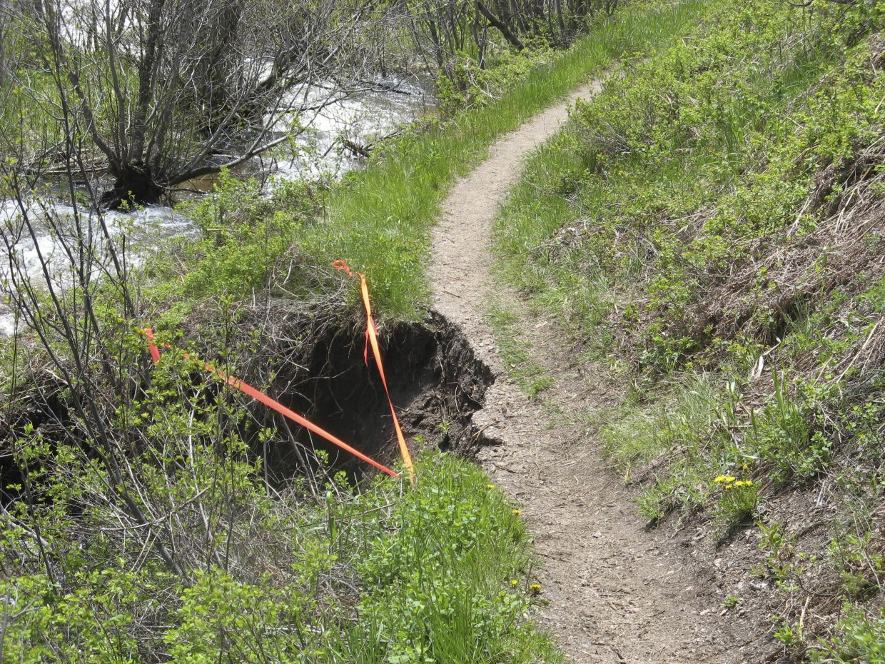 Volunteers on Friday worked to re-route the Hot Springs Trail, where a portion had been washed out.