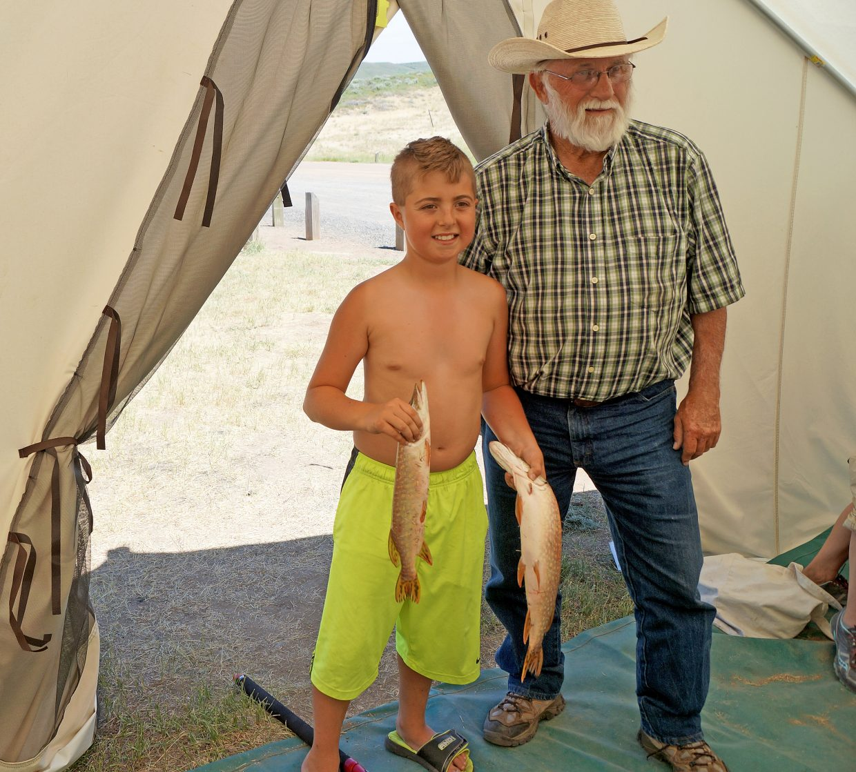Burt Clements shows off two northern pike caught by his grandson 10-year-old grandson Marek Marshall on Sunday.