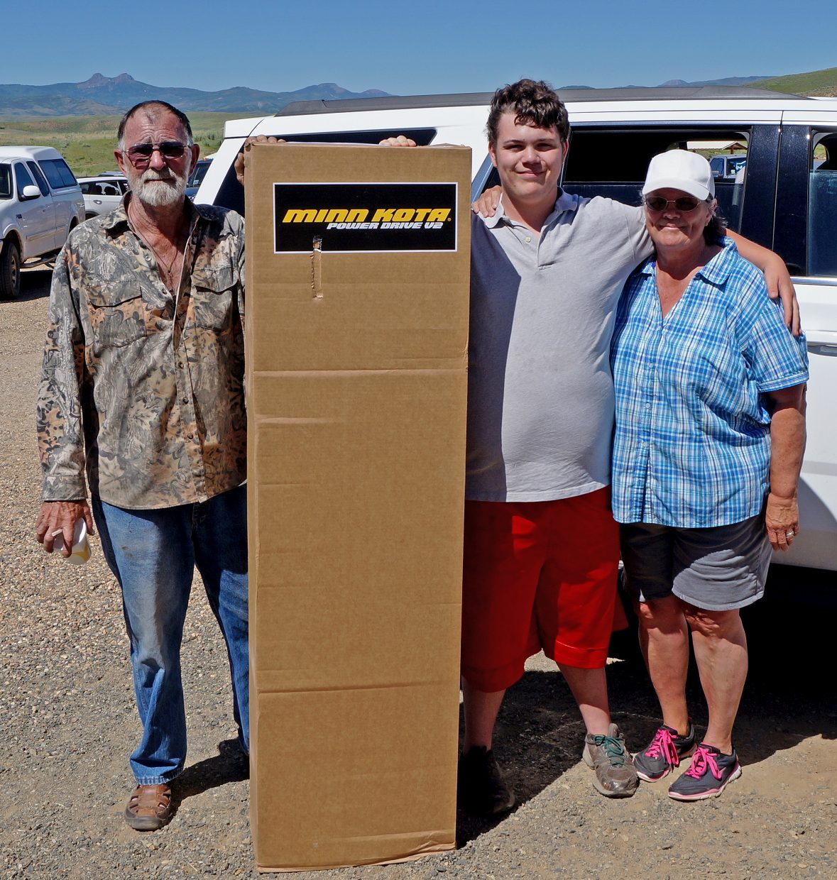 Samuel Newman, 18, with his grandfather, Gabriel Daigle and grandmother Joy Daigle, shows off his new trolling motor, which he won in the tournament.