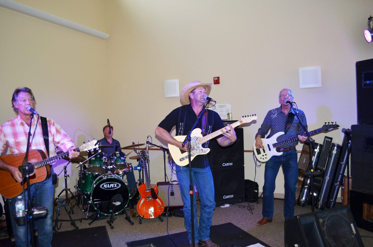 The band Loose Change performs at The Haven's annual fundraiser Friday night in Hayden. Tom Schwall, left, drummer Mark Walker, Trevor Guire and Jeff Swoyer play good old rock and roll and country for the crowd.