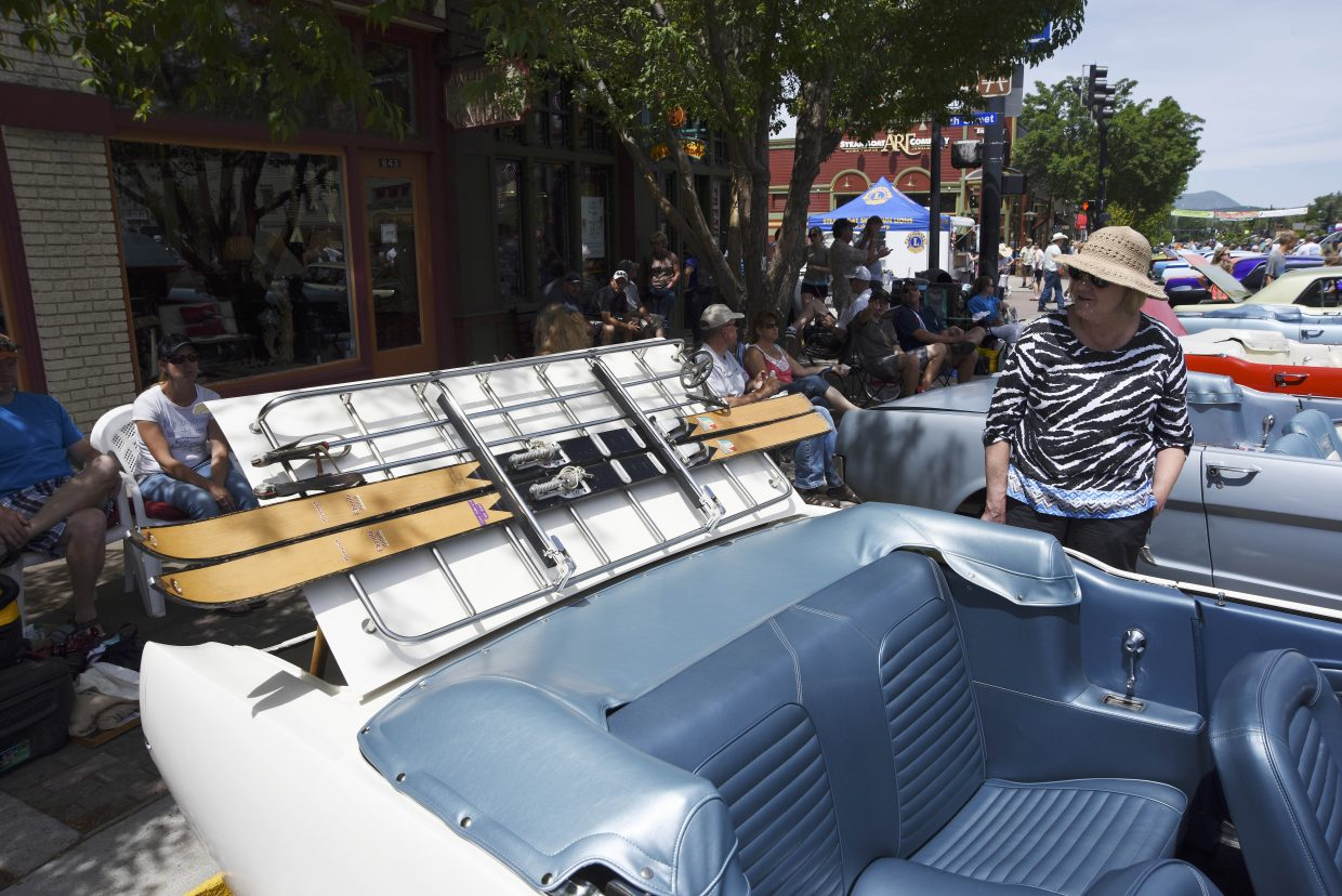 Tina Trujillo checks out a pair of wooden skis strapped to the back of Bryan Archer's 1965 Mustang convertible during the Mustang Roundup Show N' Shine on Saturday in downtown Steamboat Springs.