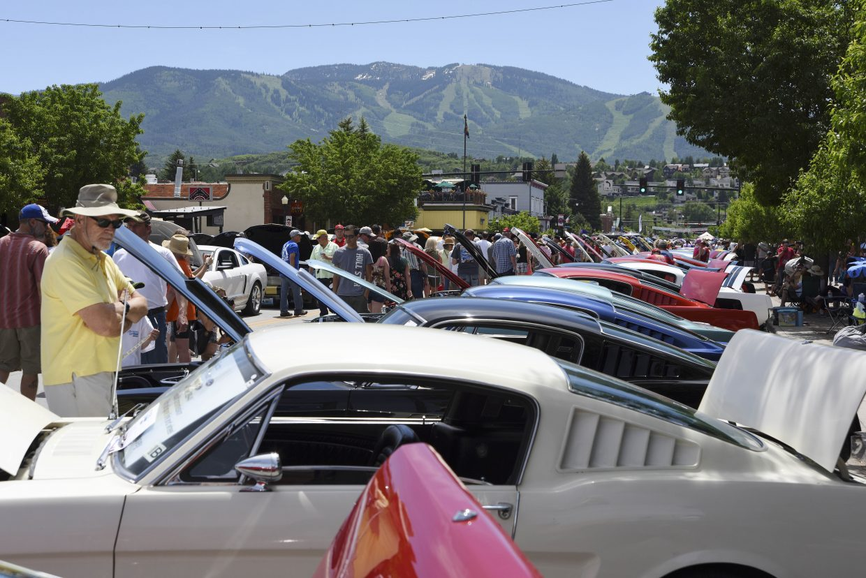Cars sit on display during the Mustang Roundup Show N' Shine on Saturday in downtown Steamboat Springs.