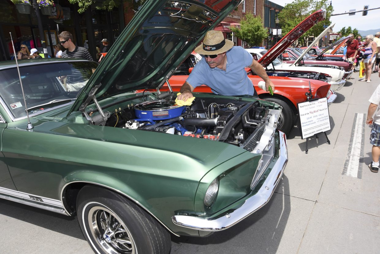 Mike Bellio polishes his 1967 Mustang Fastback during the Mustang Roundup Show N' Shine on Saturday in downtown Steamboat Springs.