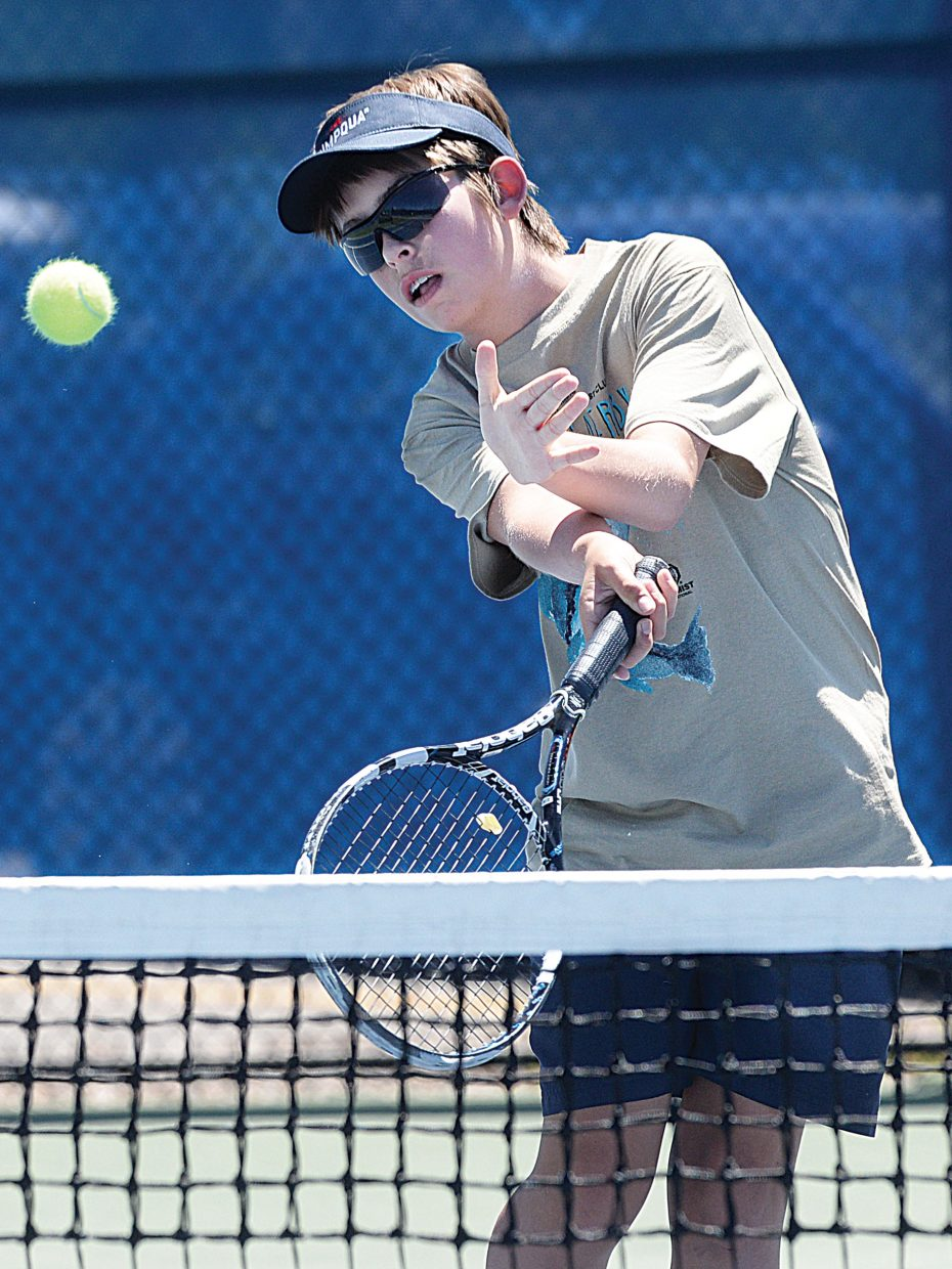 Lucas Sands returns a shot during the Junior High Performance Clinic at the Tennis Center at Steamboat Springs Monday. Young players meet from 2 to 4 p.m. daily and work with instructors to improve basic tennis skills throughout the summer.