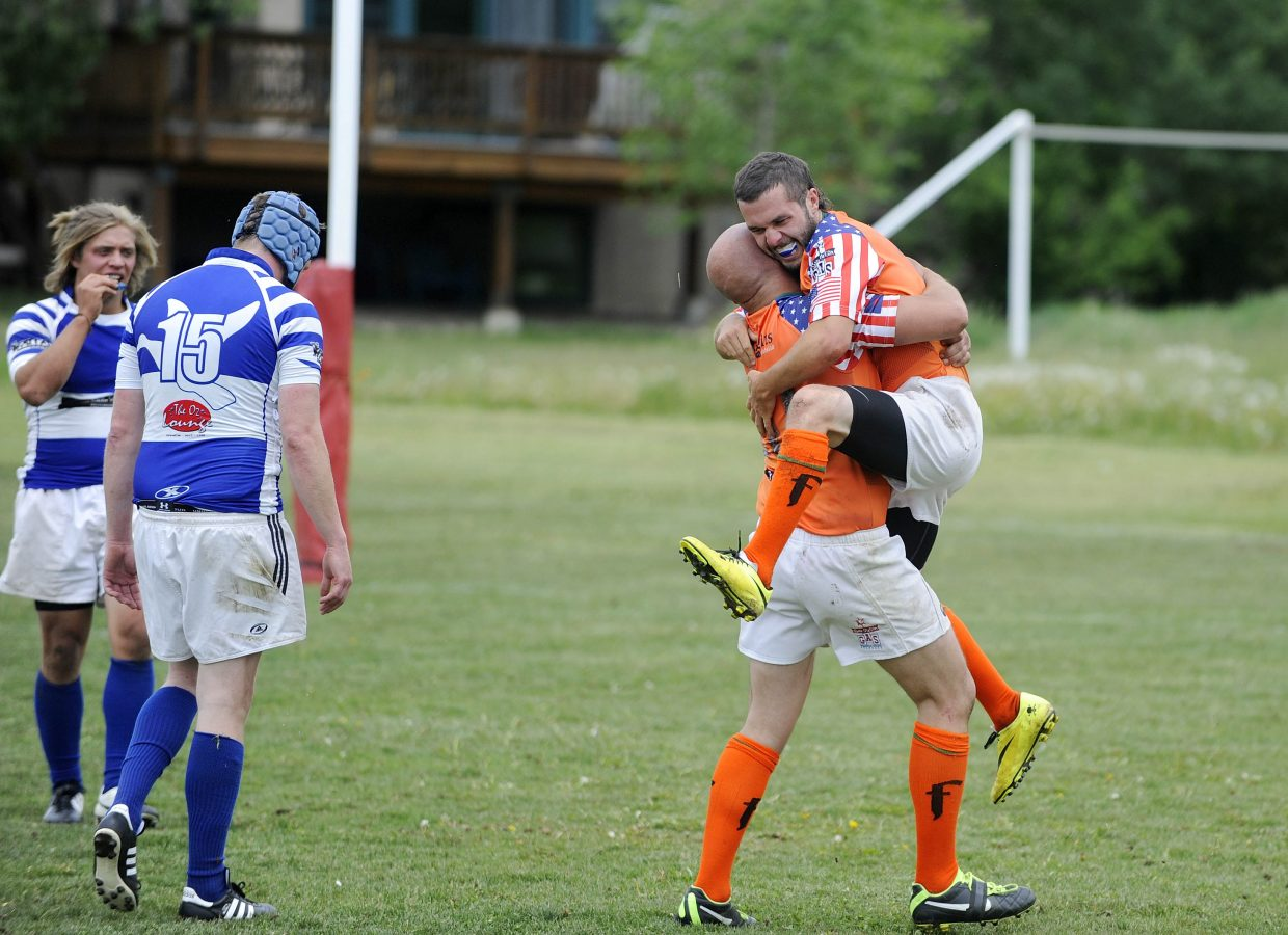 Steamboat Rugby Club member Stephen Boone celebrates after scoring during Saturday's match against Breckenridge.