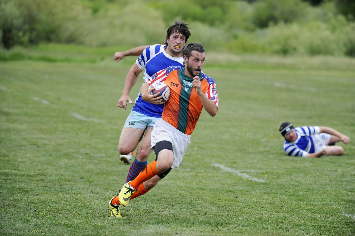 Steamboat Rugby Club member Stephen Boone runs the ball up the field to score during Saturday's match against Breckenridge.