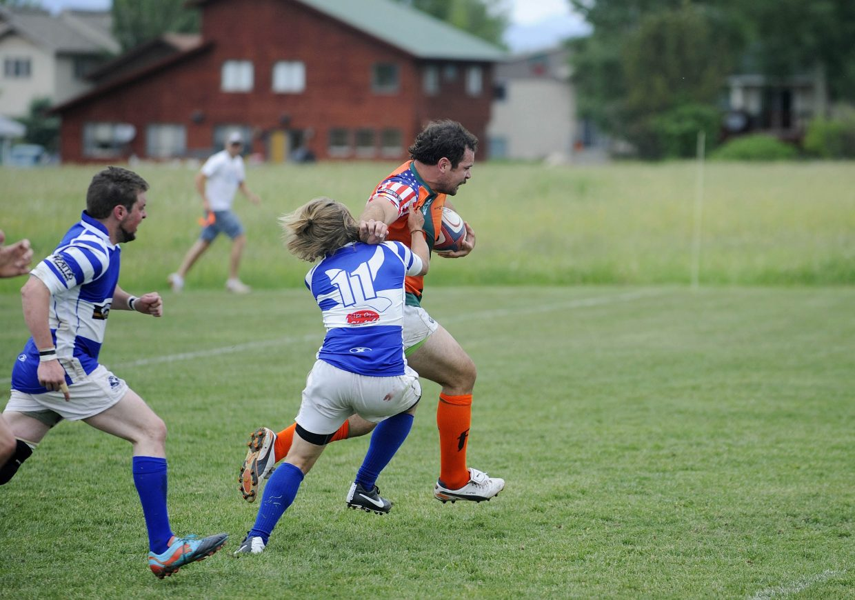 Steamboat Rugby Club member Chris Baumann runs past a Breckenridge opponent during Saturday's match.