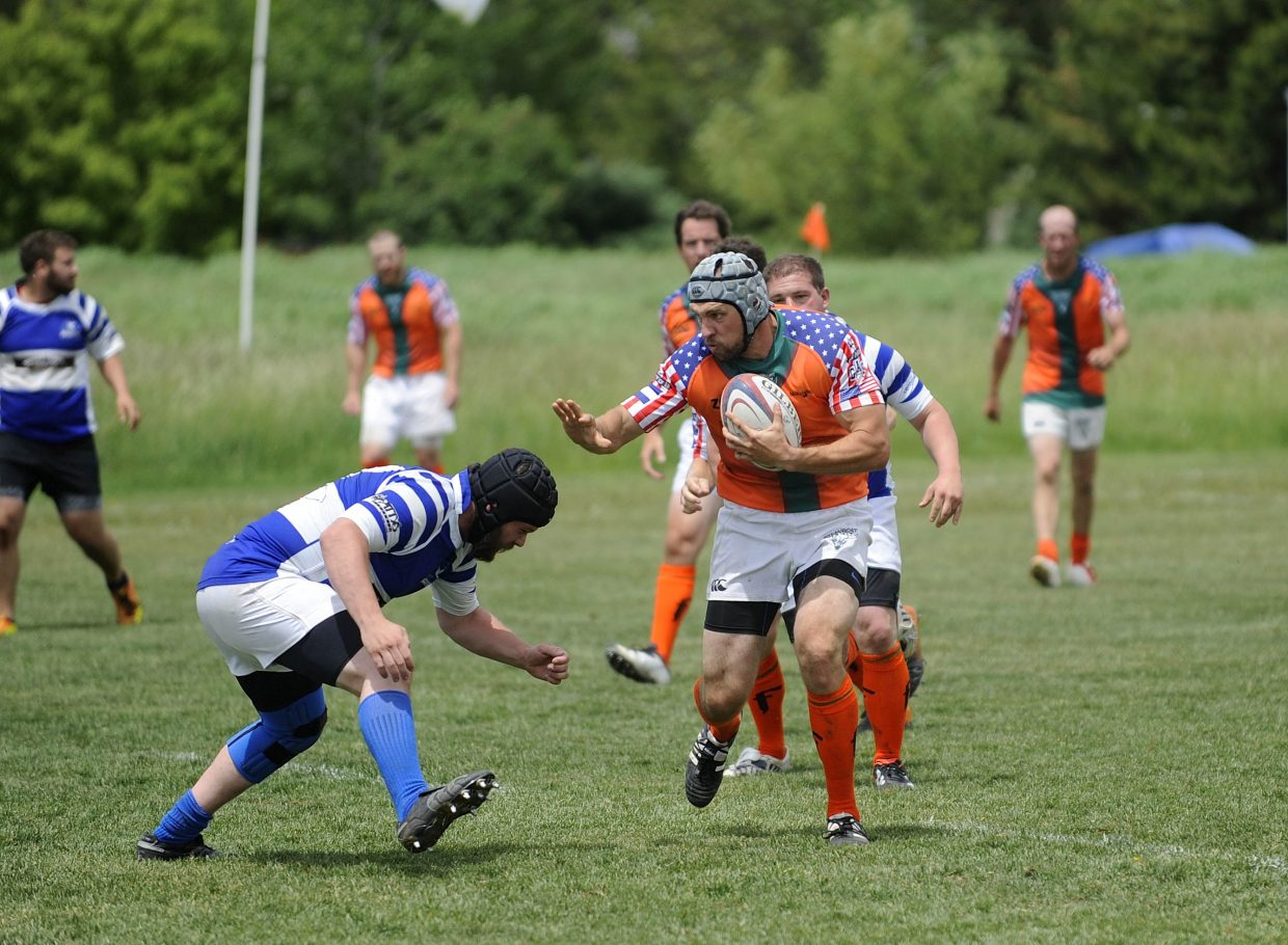 Steamboat Rugby Club member Danil Sulimov runs past a Breckenridge opponent during Saturday's match.