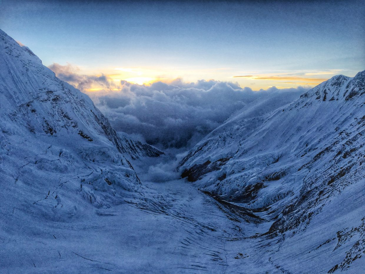 Clouds linger far below the vantage point from Camp 3, on the Lhotse Face on flanks of Mount Everest.