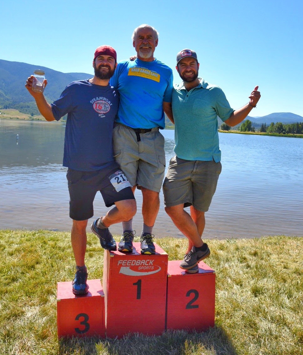 John, Danny and Michael Holland celebrate on the podium after winning the Olympic-distance relay race Sunday at the Steamboat Triathlon.