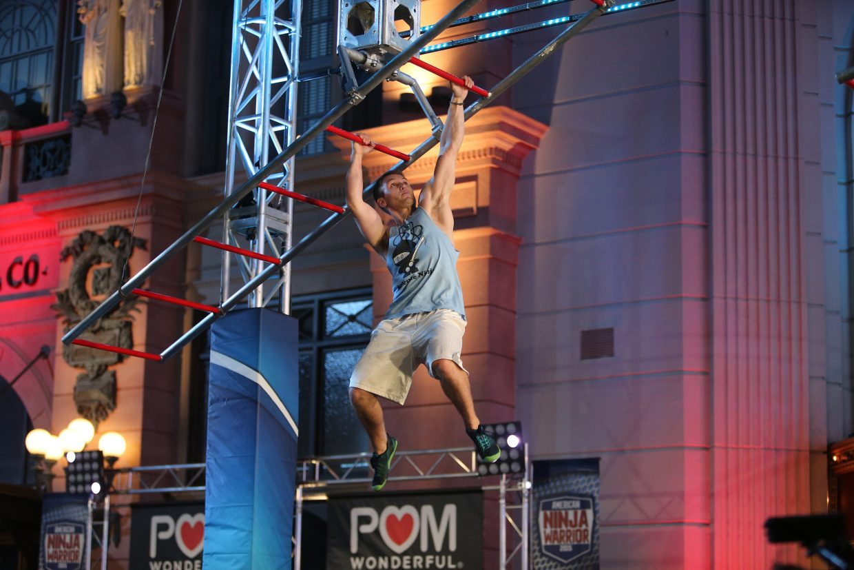 Hayden High School graduate Mitchell VeDepo works his way across the tilted ladder section of the American Ninja Warrior course in Orlando. He fell soon after, when he tried to swing from one section of ladder to another.