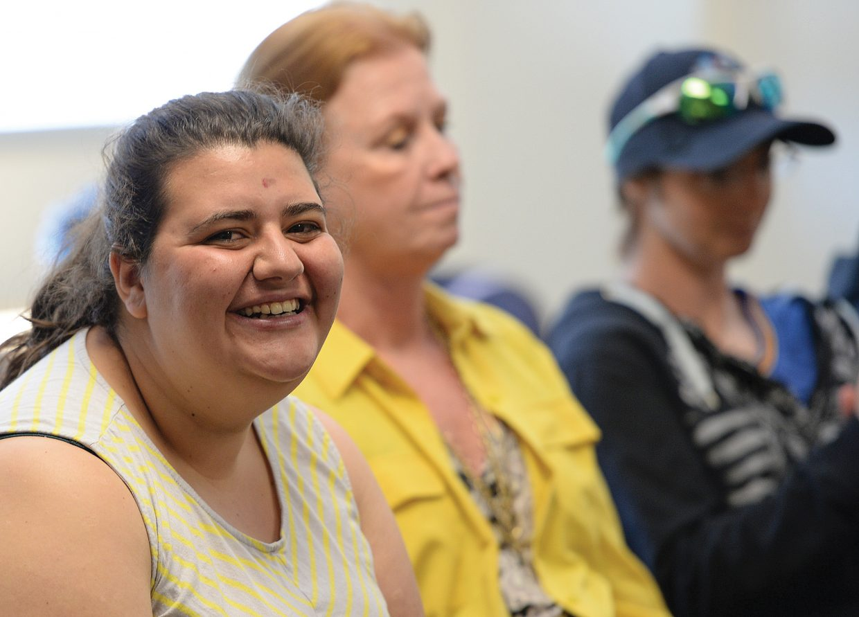 Stephanie Hart smiles while taking part in a joint workshop put on by Emerald City Opera in collaboration with Horizons Specialized Services and the Yampa Valley Autism Program to provide voice training to people with developmental disabilities. The idea is that singing is a tool adapted for each individual to increase self-awareness and learning and to create a place of safety as well as personal and emotional growth.