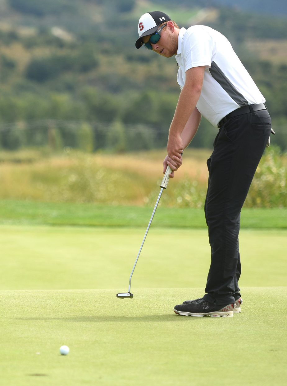 Steamboat senior Jacob Taulman watches his putt coast toward the hole Tuesday at Haymaker Golf Course.