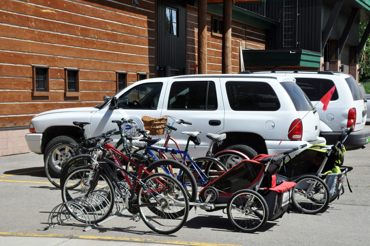 Bicycles ridden by city employees are parked next to city of Steamboat Springs vehicles outside of the parks and recreation building. The city's Green Team promoted biking and using public transportation to get to and from work and for running errands. The city is working to form a new advisory committee on sustainability.