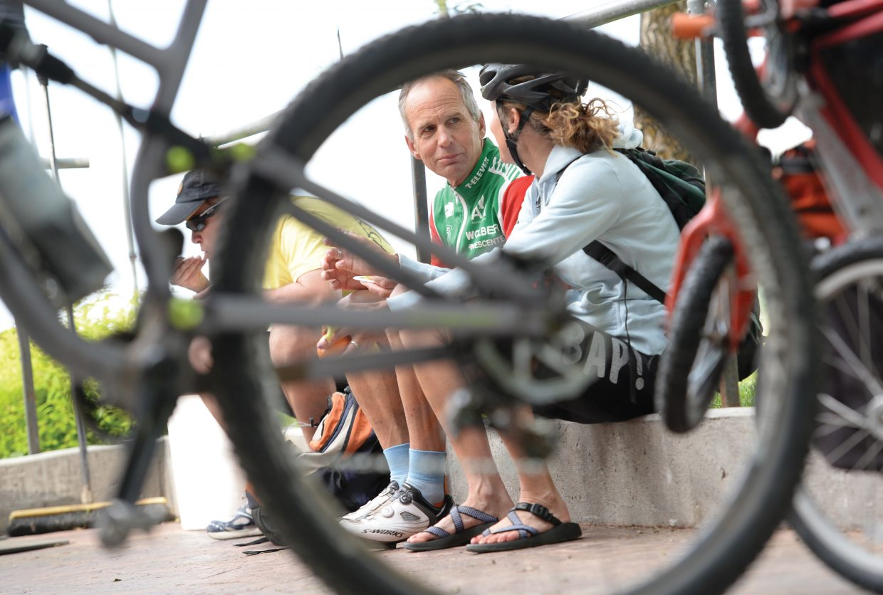 Jim Barker visits with Sarah Martino during The Bike to Work Breakfast Wednesday morning at Ski Haus. Wednesday was bike to work day, and Ski Haus invited local cyclist to come by during their commute to work for a bite to eat.