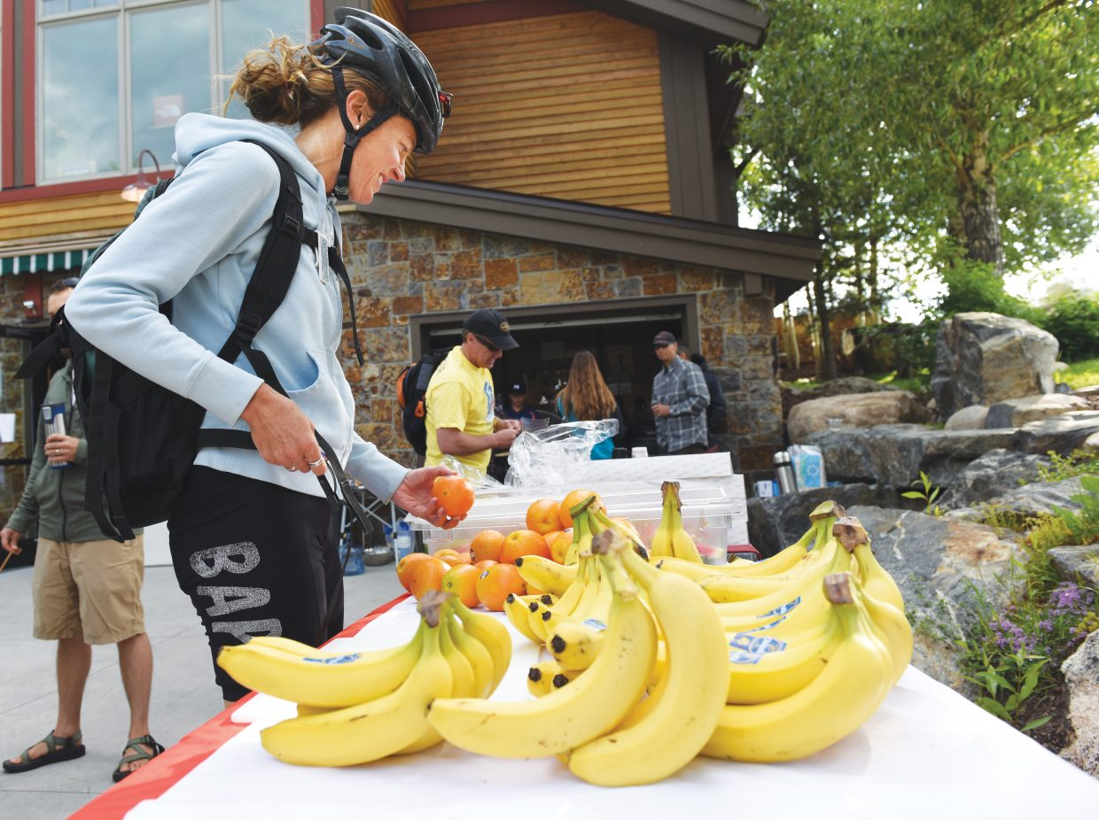 Cyclist Sarah Martino grabs a piece of fruit at the Bike to Work Breakfast Wednesday morning at Ski Haus. Wednesday was Bike to Work Day, and Ski Haus invited local cyclist to come by during their commute to work for a bite to eat.
