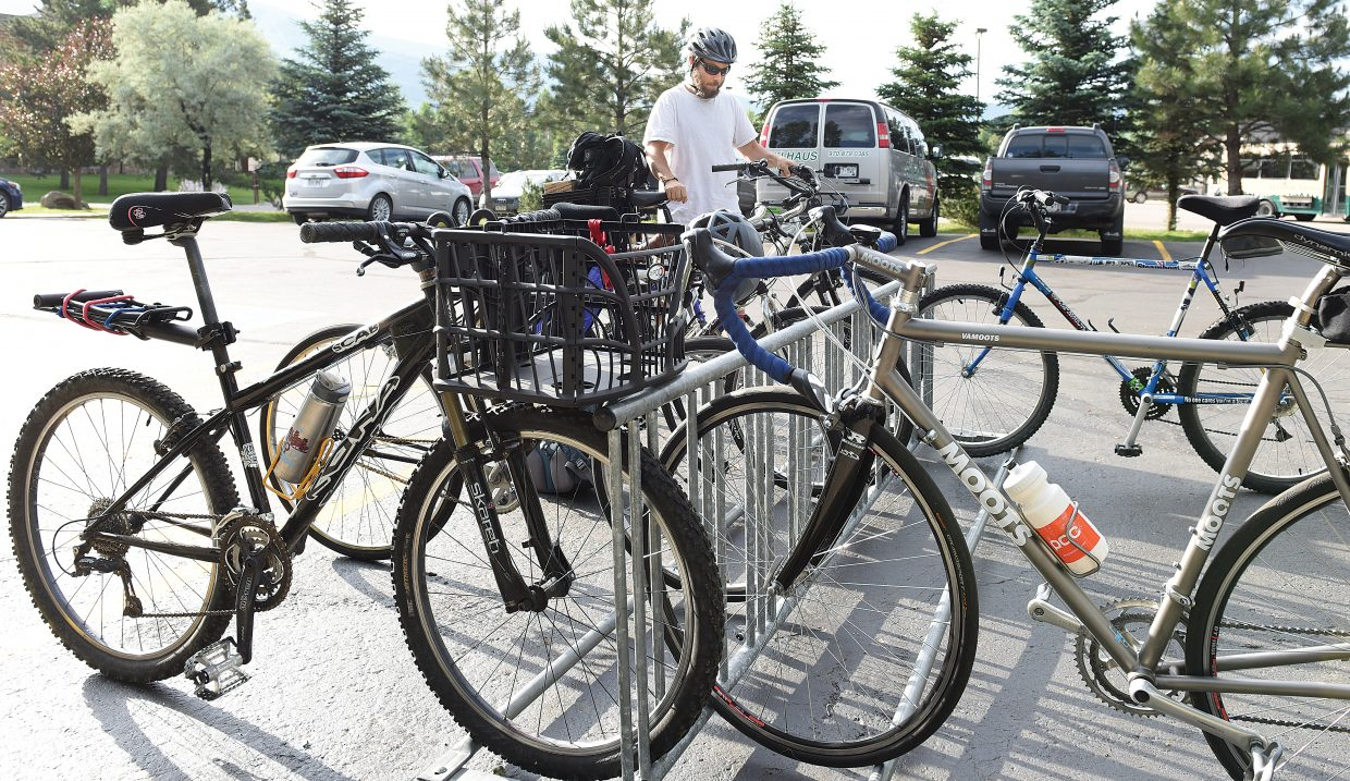Cyclist Alan Goldich pulls his bike out of the rack at Ski Haus after enjoying the Bike to Work Breakfast Wednesday morning at Ski Haus. Wednesday was Bike to Work Day, and Ski Haus invited local cyclist to come by during their commute to work for a bite to eat.