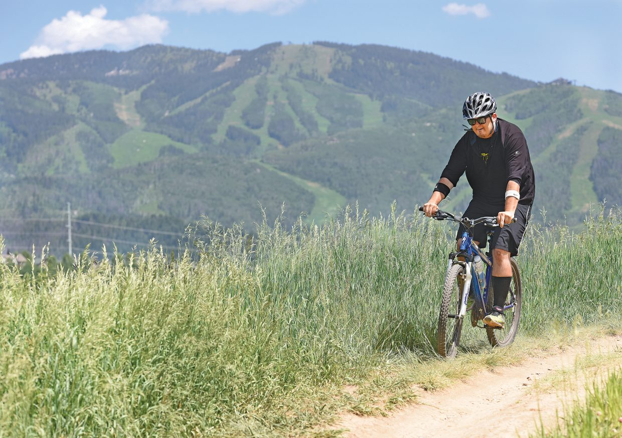 Steamboat Pilot & Today sports reporter Austin Colbert makes his way along the Bluffs route on Emerald Mountain.