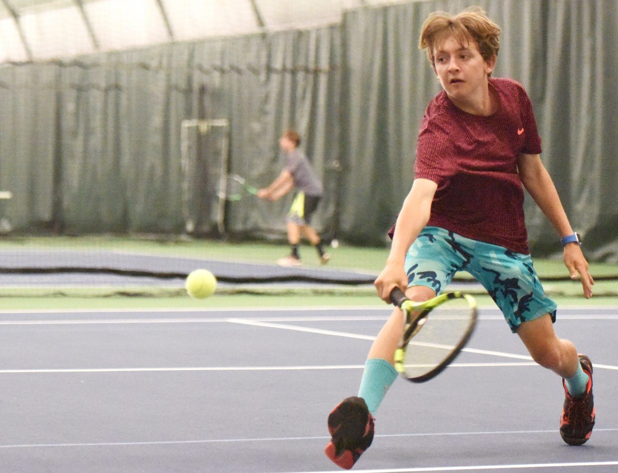 Wyatt Stempel lunges for a ball Saturday during the LuvBoat tennis tournament at the Tennis Center at Steamboat Springs. The event drew about 60 players in adult mixed doubles and juniors brackets.